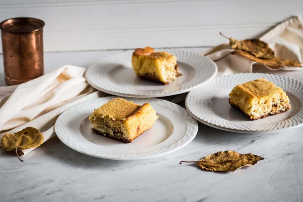 Pumpkin cheesecake bars on plates