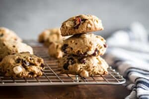three gluten free white chocolate cranberry cookies stacked on top of each other