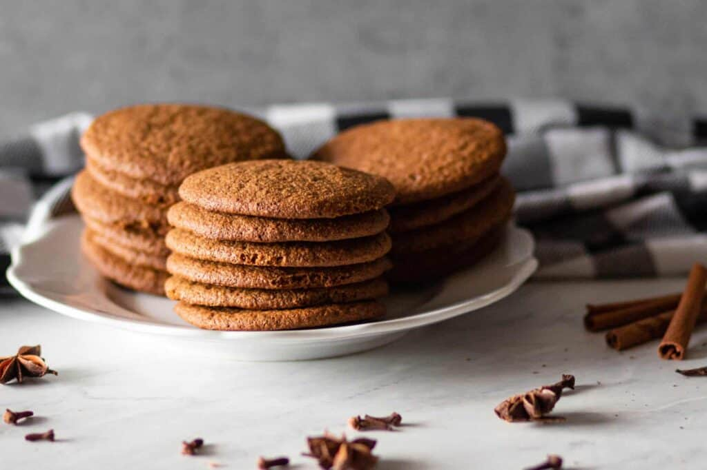 a plate with gluten free gingersnap cookies stacked on it