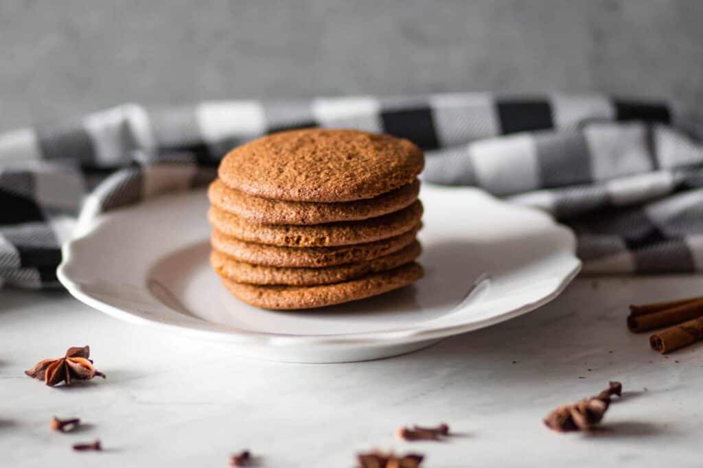 a plate with a stack of gluten free gingersnap cookies