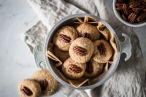 bowl full of gluten free butter pecan cookies for gluten free game day snacks