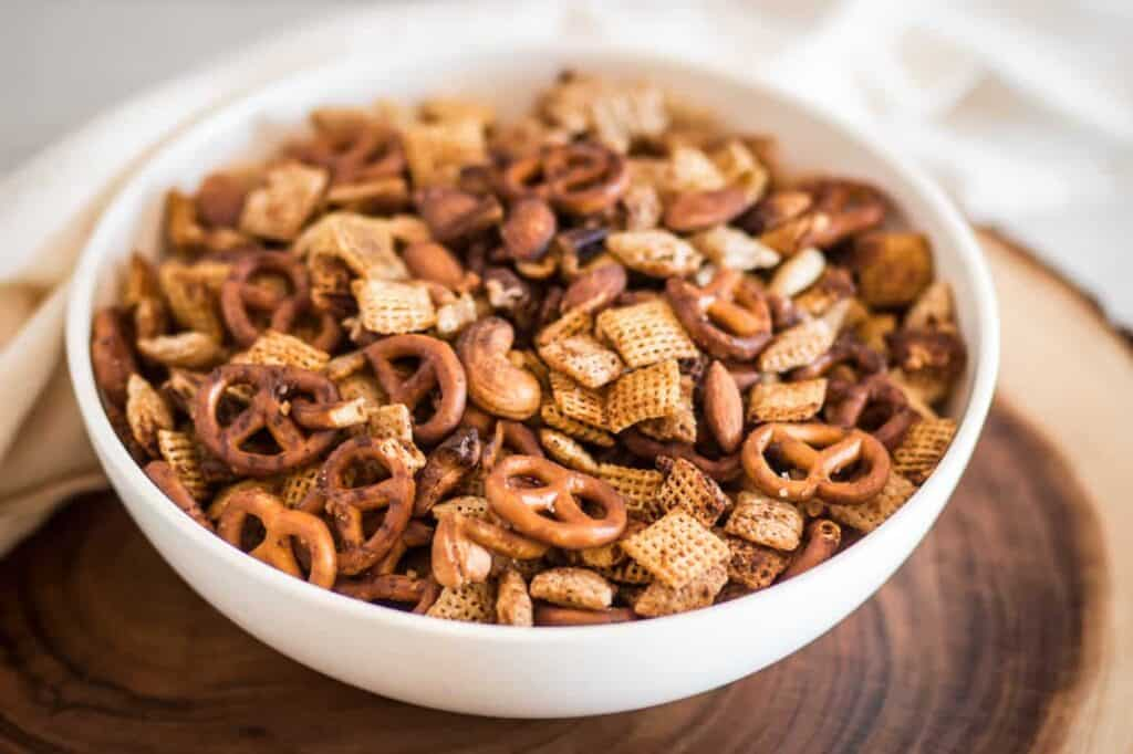 a bowl of gluten free air fryer chex mix is part of my top 10 gluten free recipes of 2020