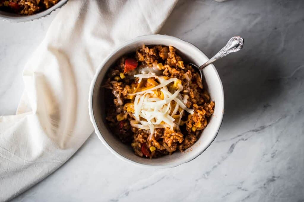 a white bowl of instant pot mexican style beef and rice