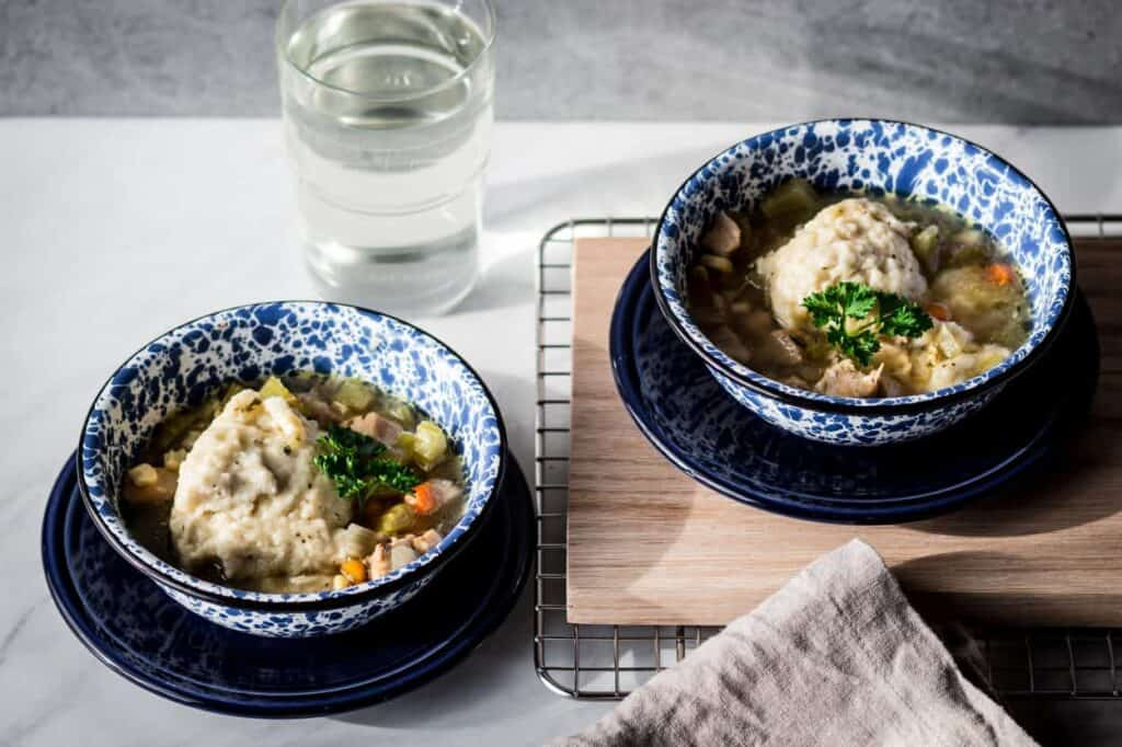 two bowls of gluten free instant pot chicken and dumplings