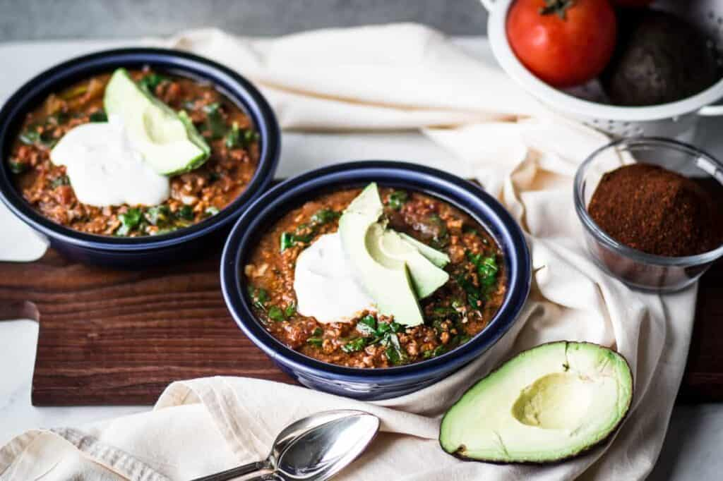 two blue bowls of gluten free instant pot taco soup
