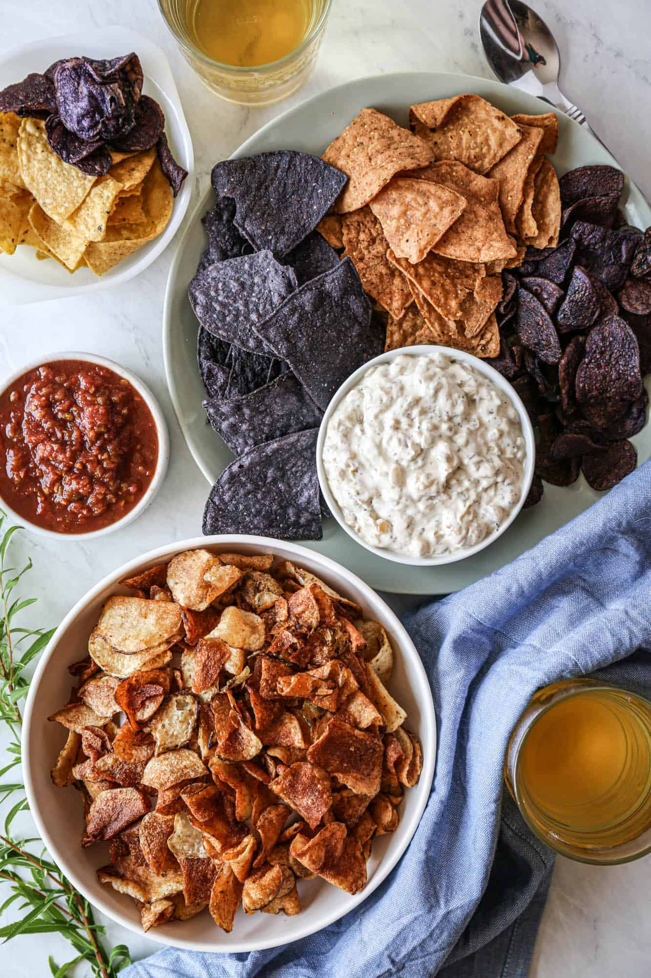 a bowl of gluten free caramelized onion dip with tortilla and potato chips