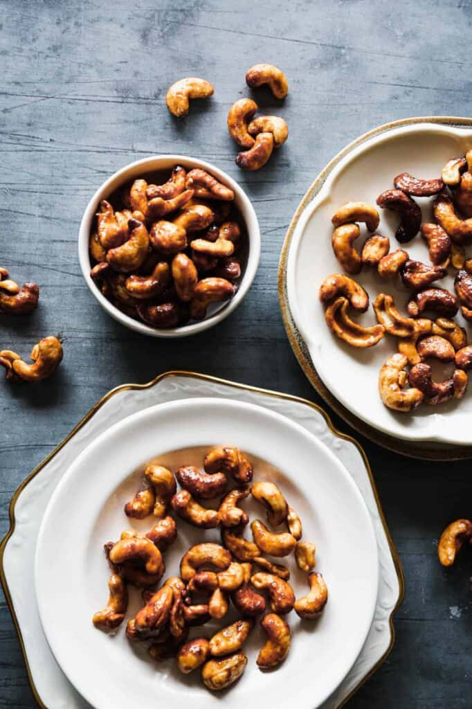 a plate and some bowls of gluten free air fryer sweet and salty roasted cashew nuts