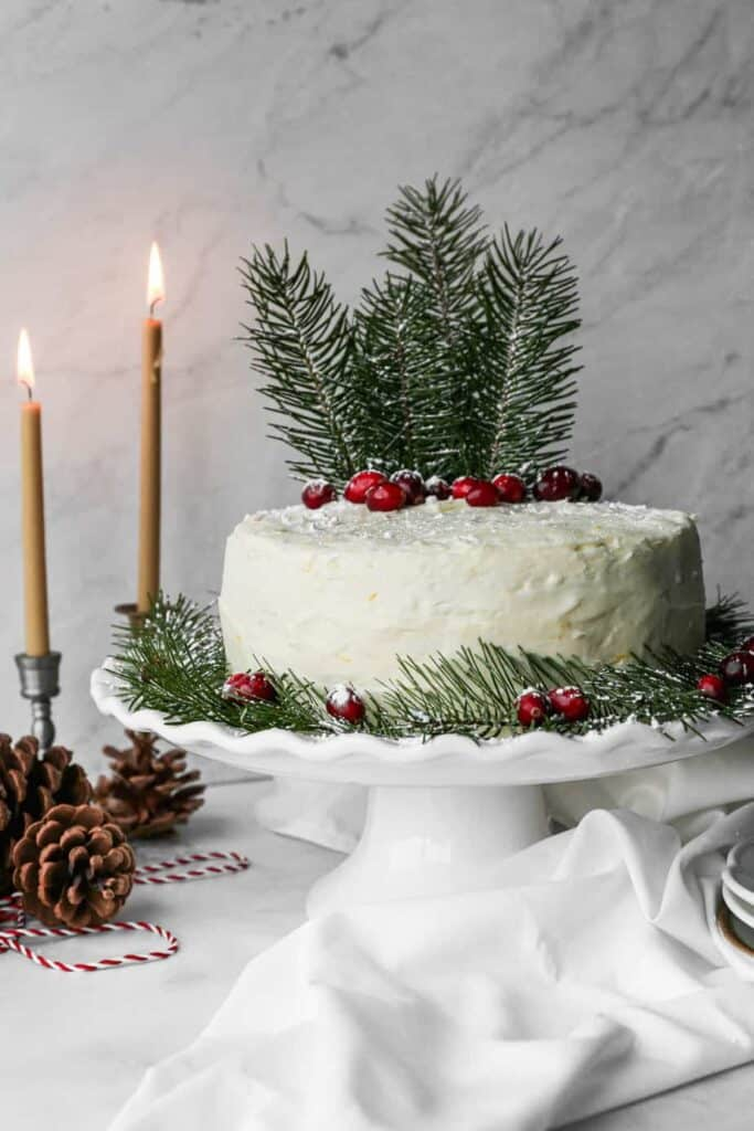 a gluten free orange cranberry cake with cranberry filling and orange buttercream frosting