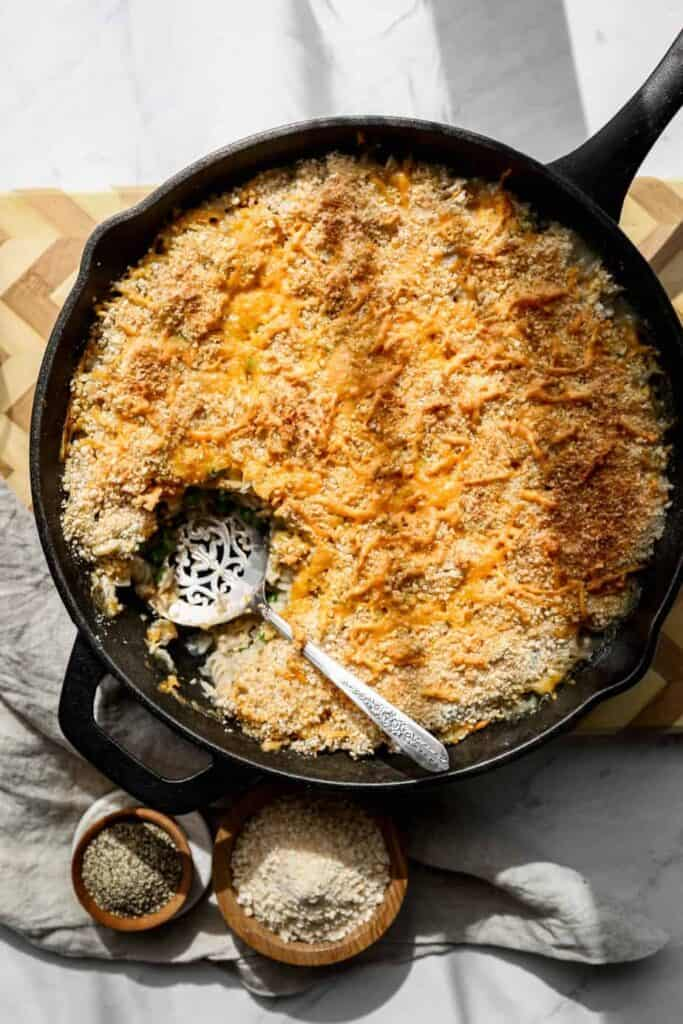 a twelve inch cast iron frying pan of gluten free tuna casserole skillet with shredded cheddar cheese and gluten free breadcrumbs browned on top